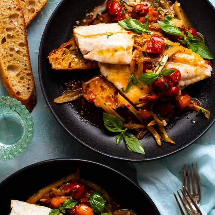 Overhead photo of 2 plates of Acqua Pazza - Italian Poached Fish