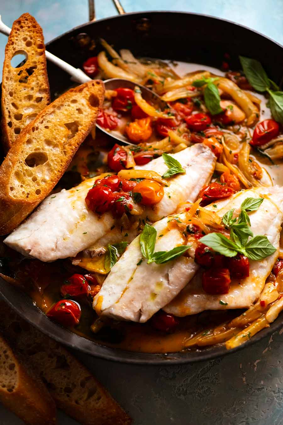 Acqua Pazza - Italian Poached Fish in a skillet, fresh off the stove