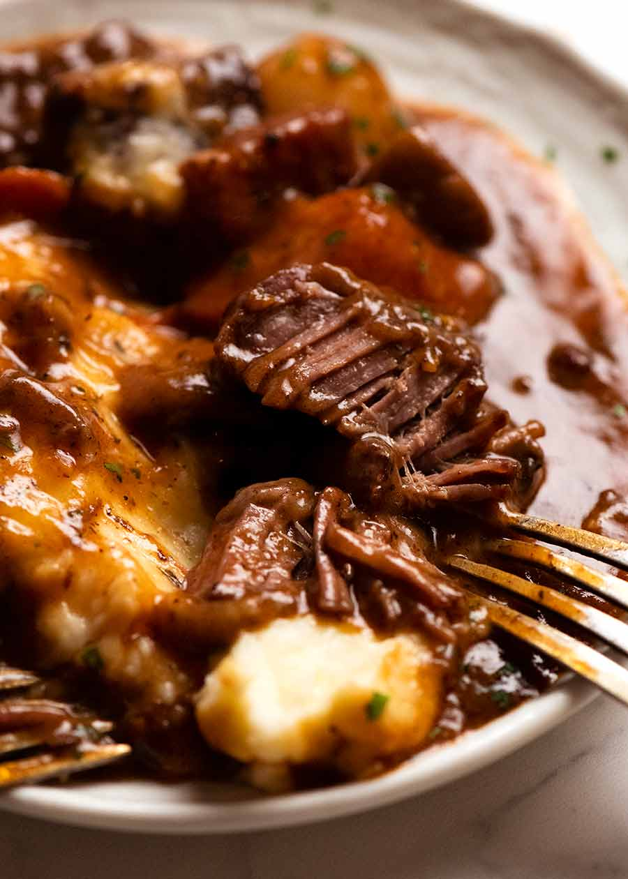 Close up showing fork tender Beef Bourguignon meat