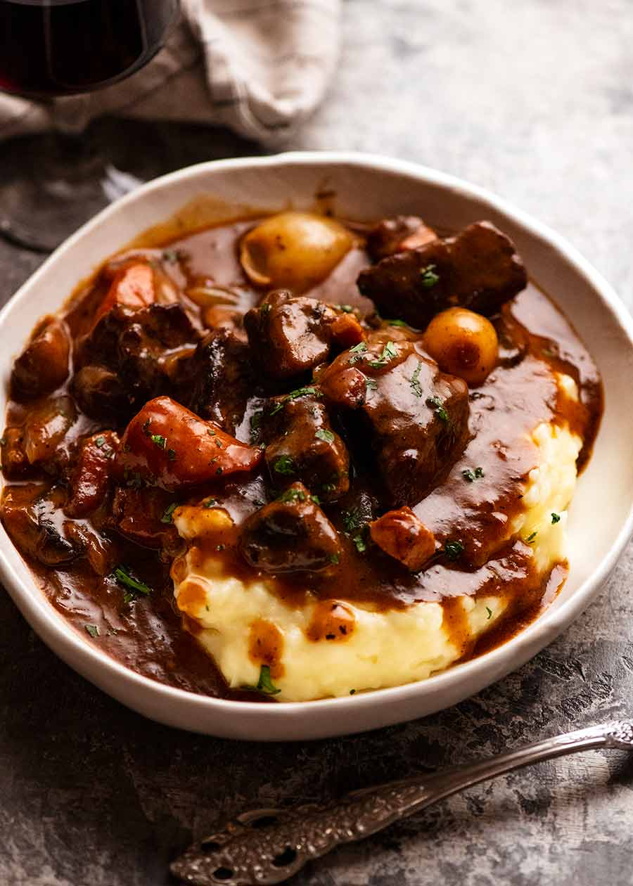 Beef Bourguignon served over creamy mashed potato