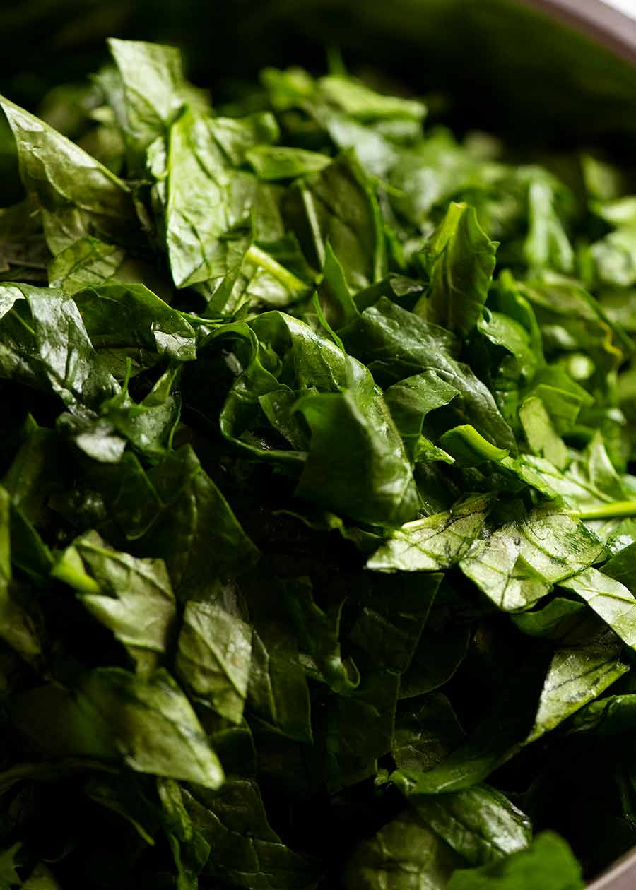 Bowl of chopped fresh spinach for Palak Paneer