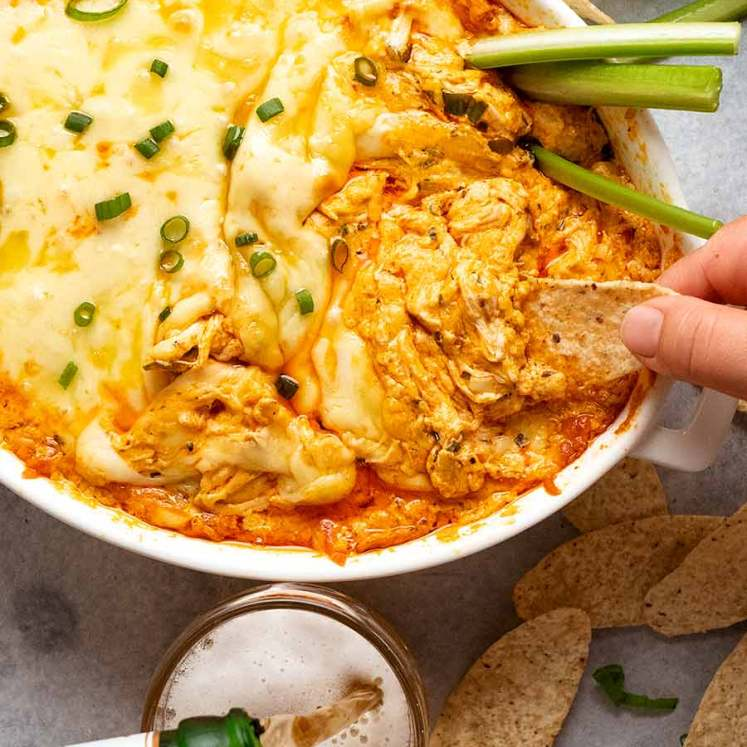 Overhead photo of people eating Hot Buffalo Chicken Dip