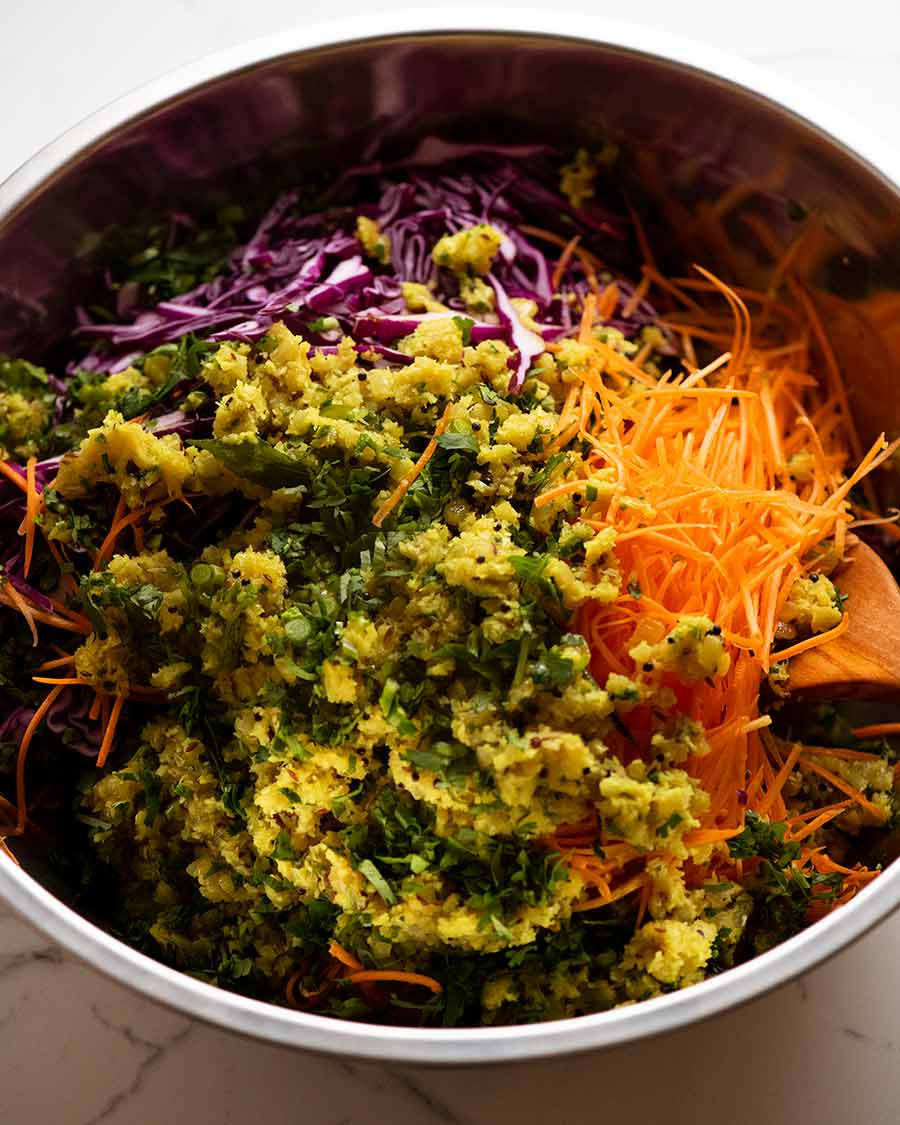Indian Cabbage Carrot Salad in a bowl, ready to be tossed