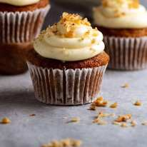 Close up photo of Carrot Cake Cupcakes with Cream Cheese Frosting