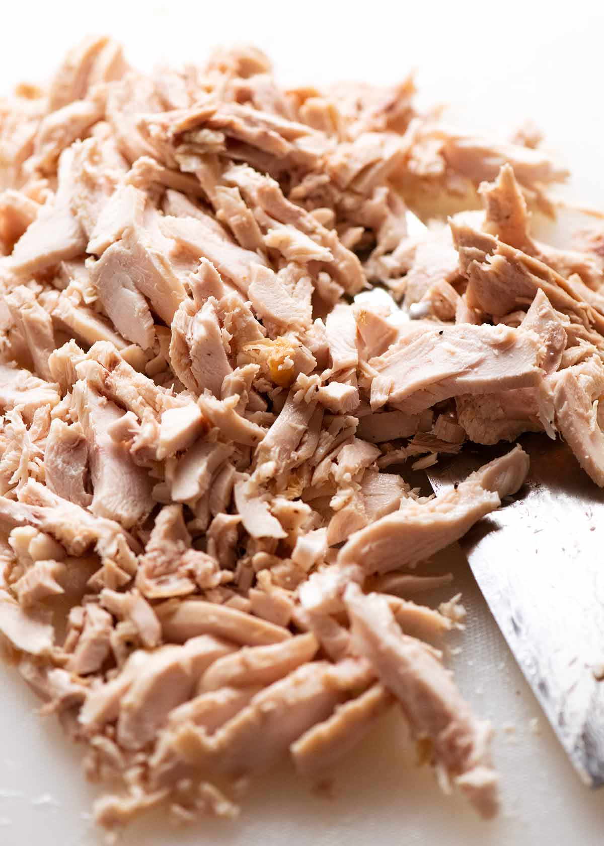 Pile of finely chopped Chicken for Creamy Chicken Pasta
