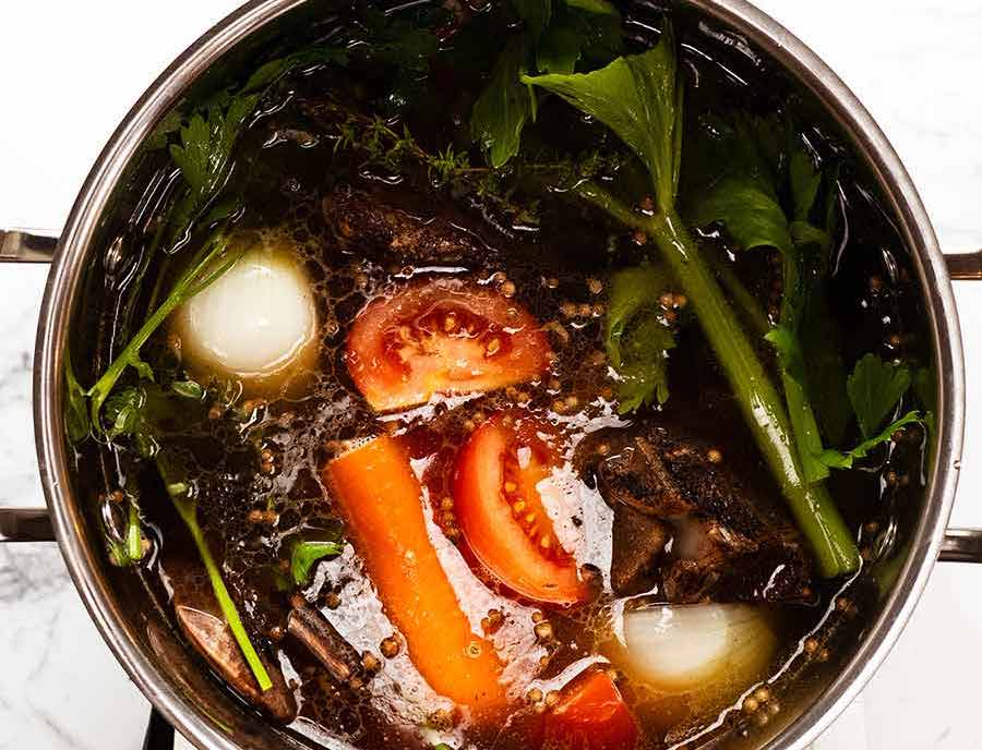 Pot of Homemade Beef Stock simmering on the stove