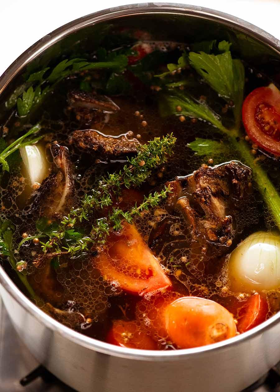 Pot of beef stock simmering