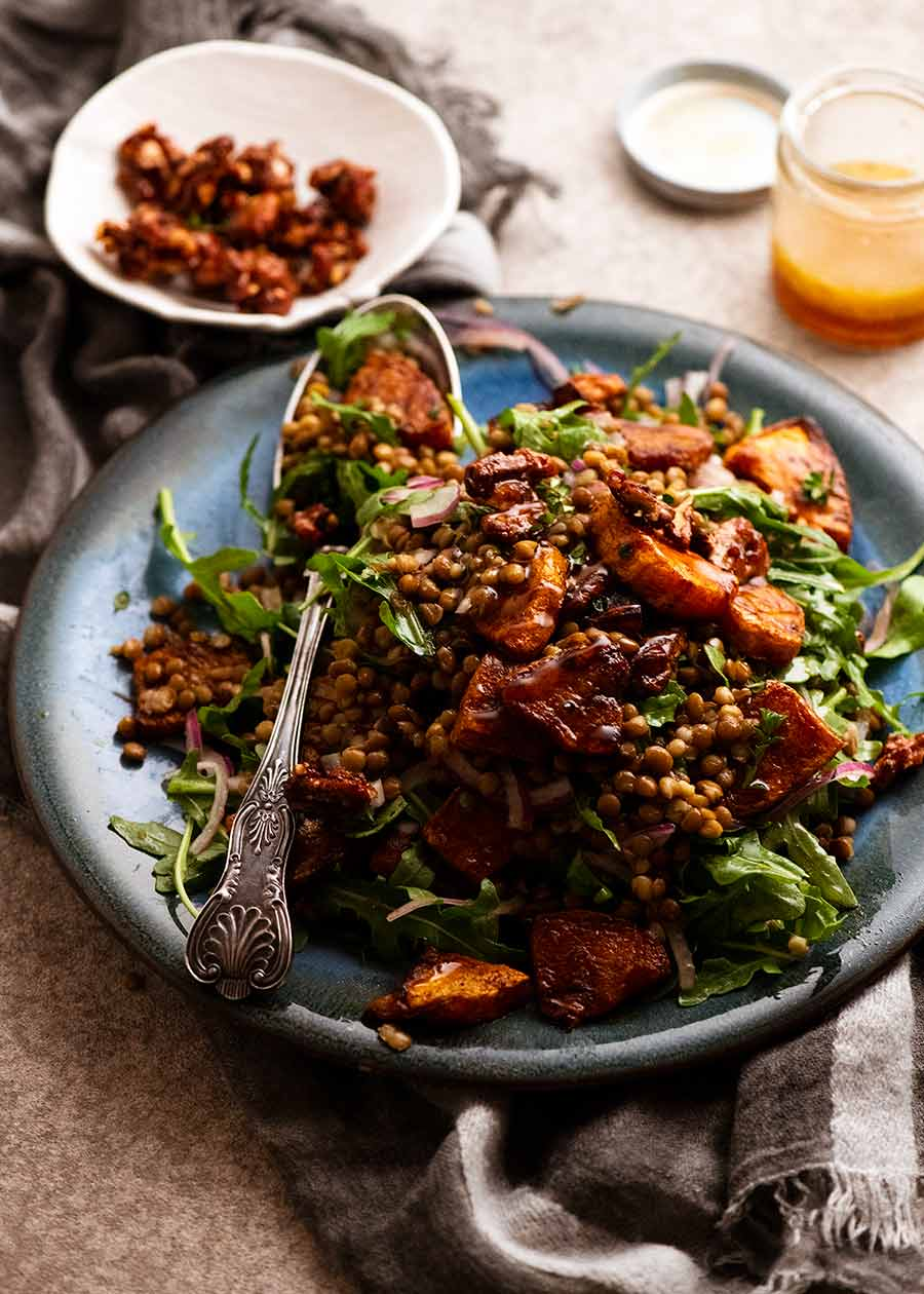 Platter piled high with Honey Cinnamon Pumpkin Lentil Salad
