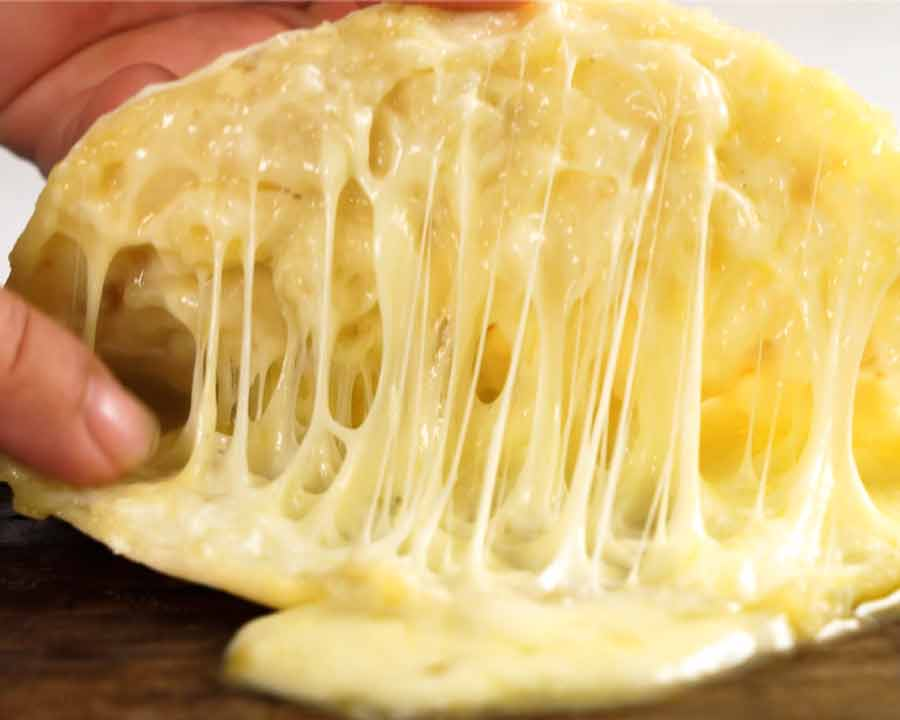 Showing the inside of Cheese Naan