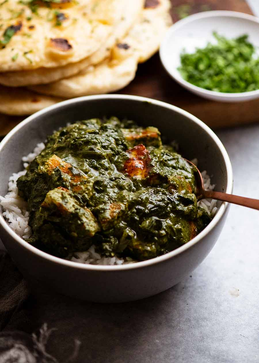 Palak Paneer in a bowl, served over basmati rice