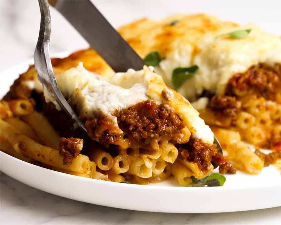 Close up of fork eating Pastitsio (Greek pasta bake)