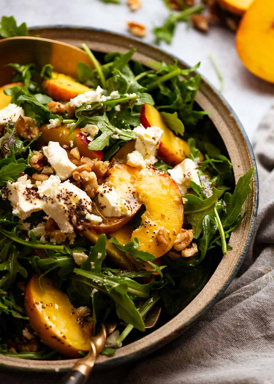 Bowl piled high with Peach Salad with Poppyseed Dressing