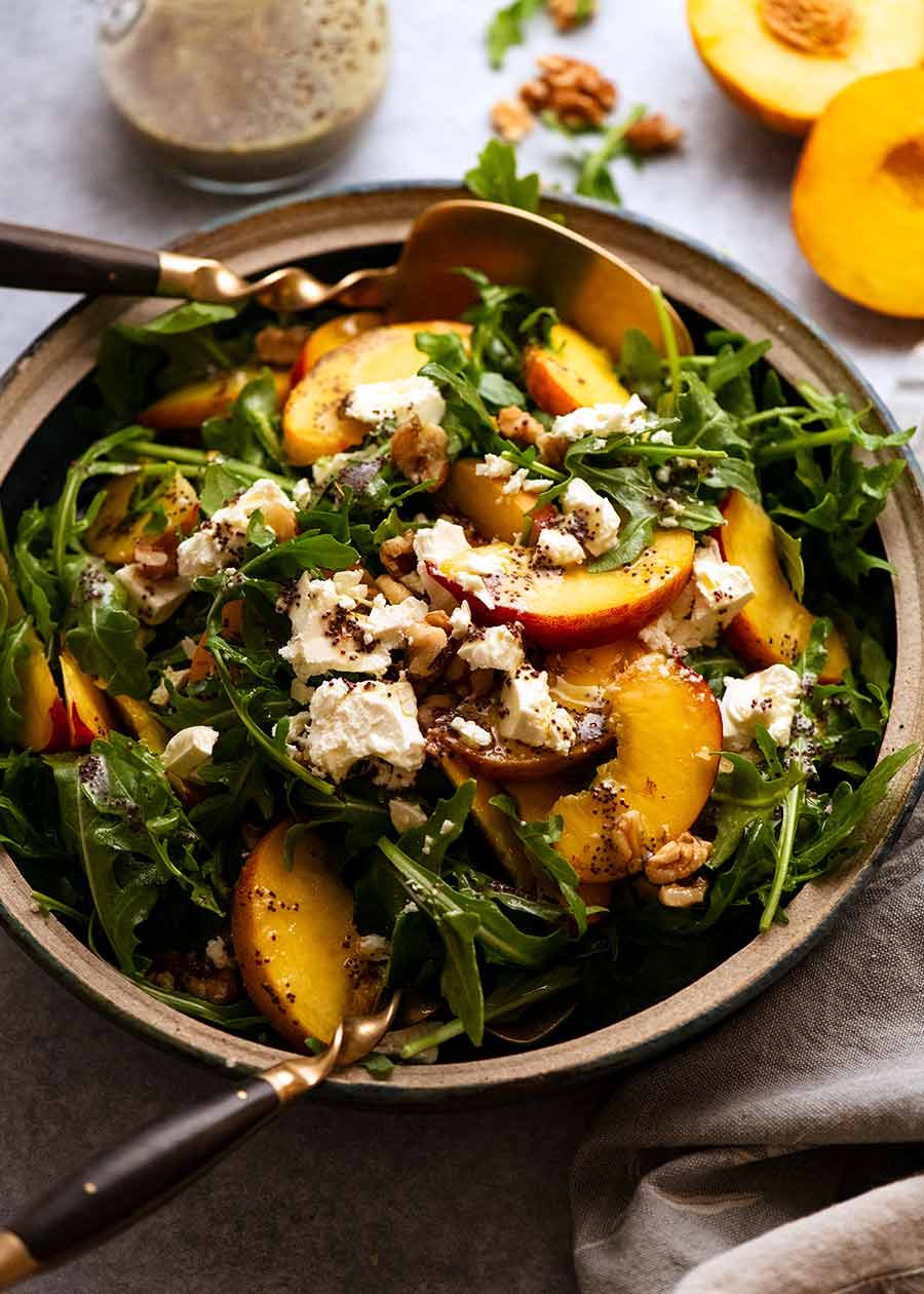 Peach Salad with Poppyseed Dressing in a bowl, ready to be served