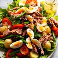 Close up of platter piled high with Salad Nicoise - French Tuna Salad