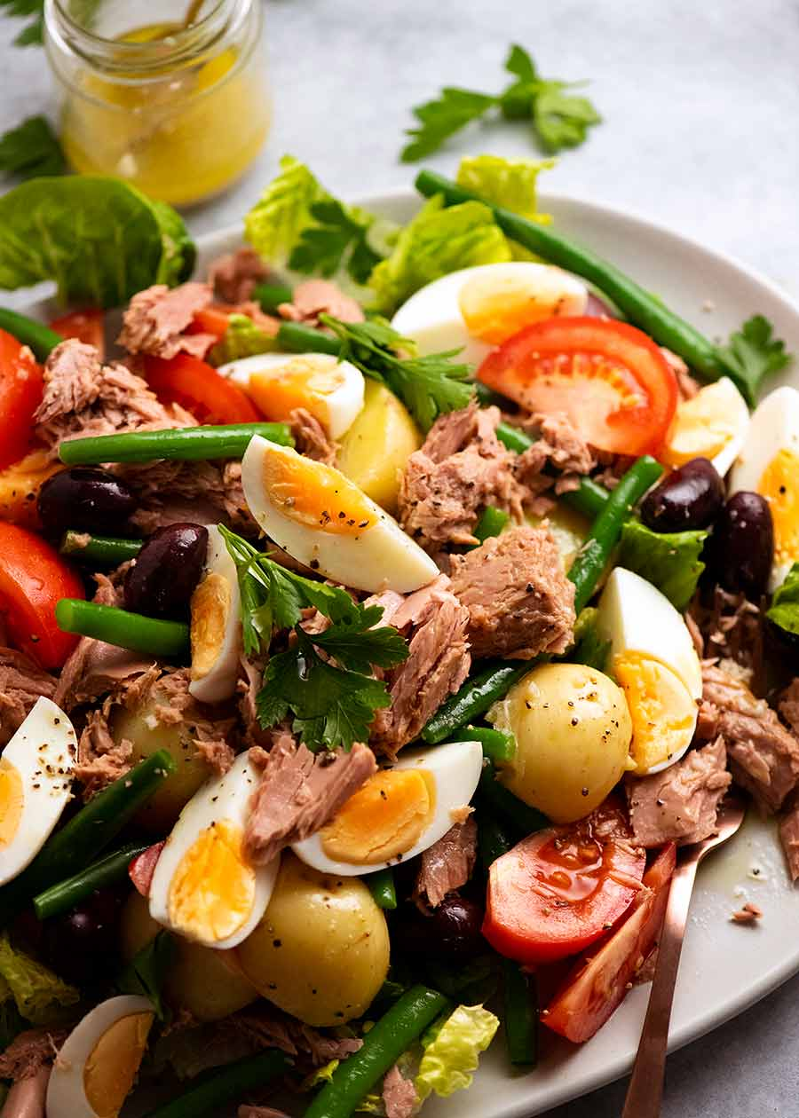 Big plate of Salad Nicoise - French Tuna Salad, ready to be eaten