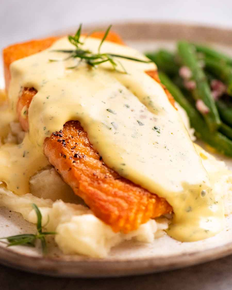 Salmon on a plate smothered in Bearnaise Sauce