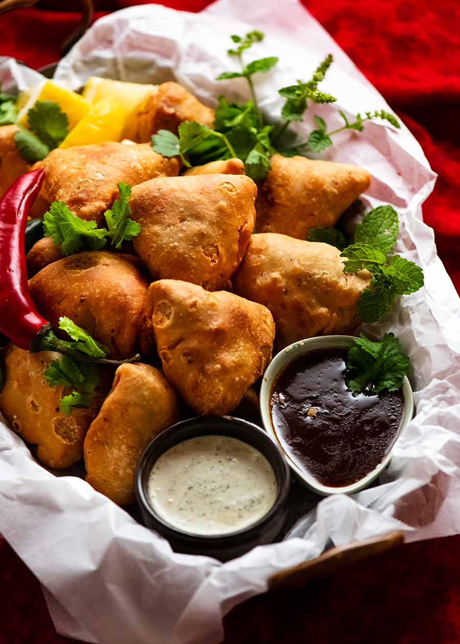 Pile of Samosas on a plate, ready to be eaten