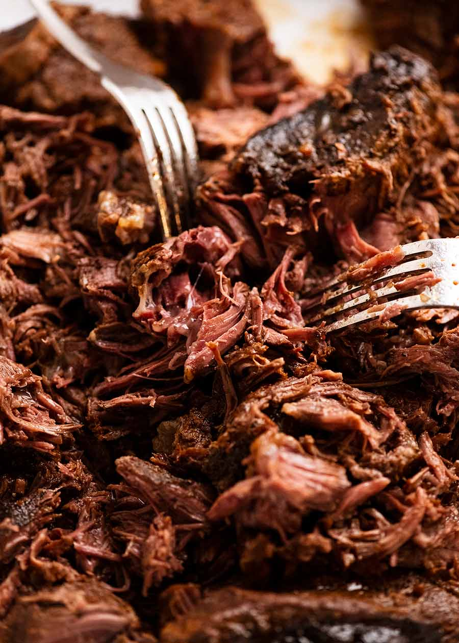 Using forks to shred Beef Barbacoa