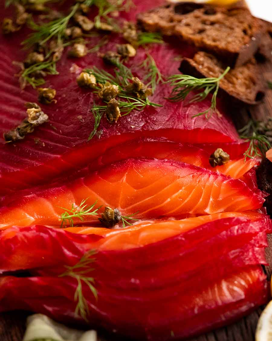 Close up photo showing slices of Beetroot Cured Salmon (Gin or Vodka, Salmon Gravlax)