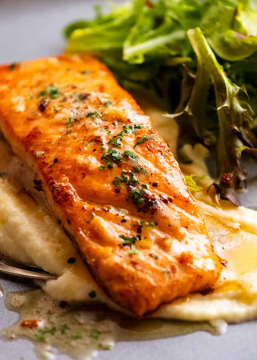 Garlic Butter Salmon on a plate with creamy cauliflower puree