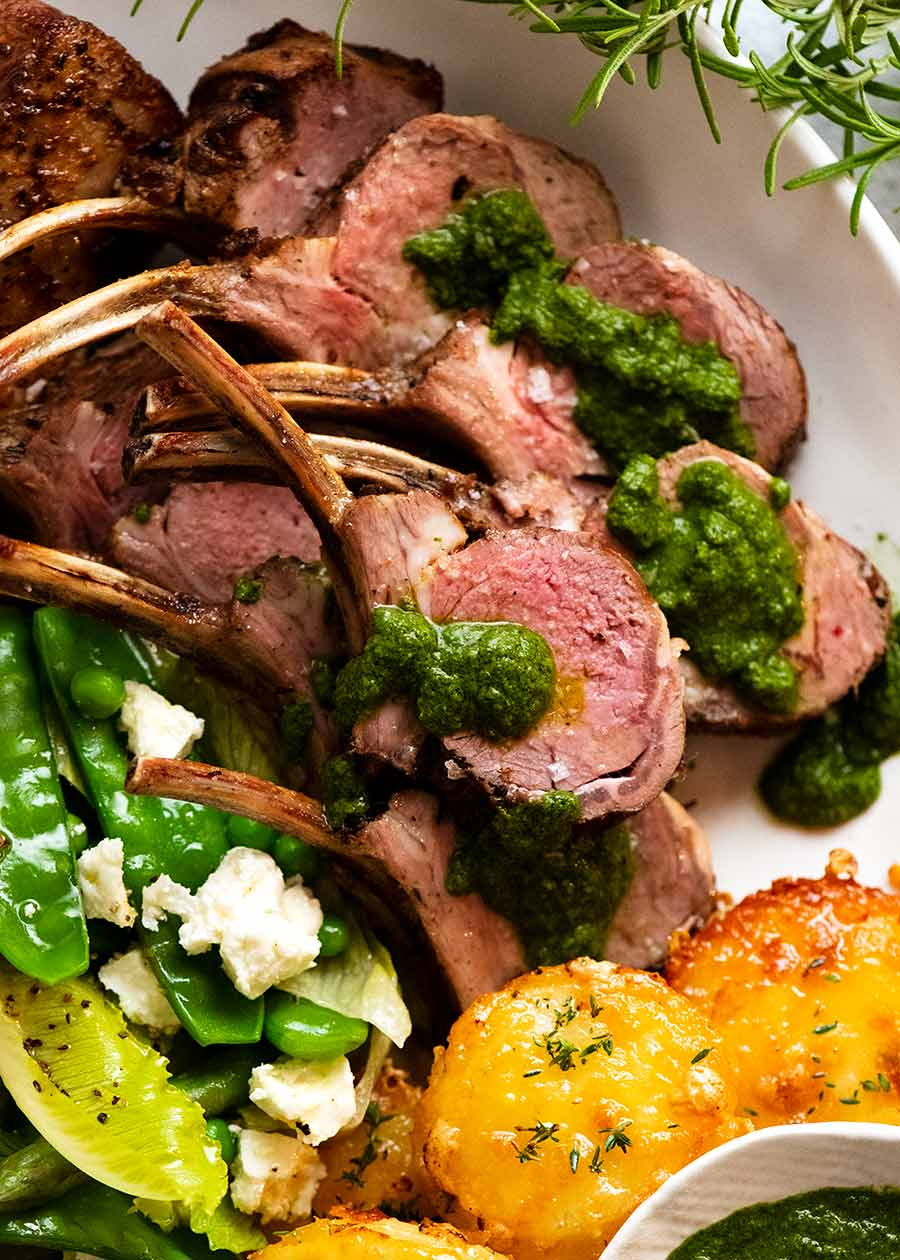 Close up of Rack of Lamb slices on a plate served with salsa verde