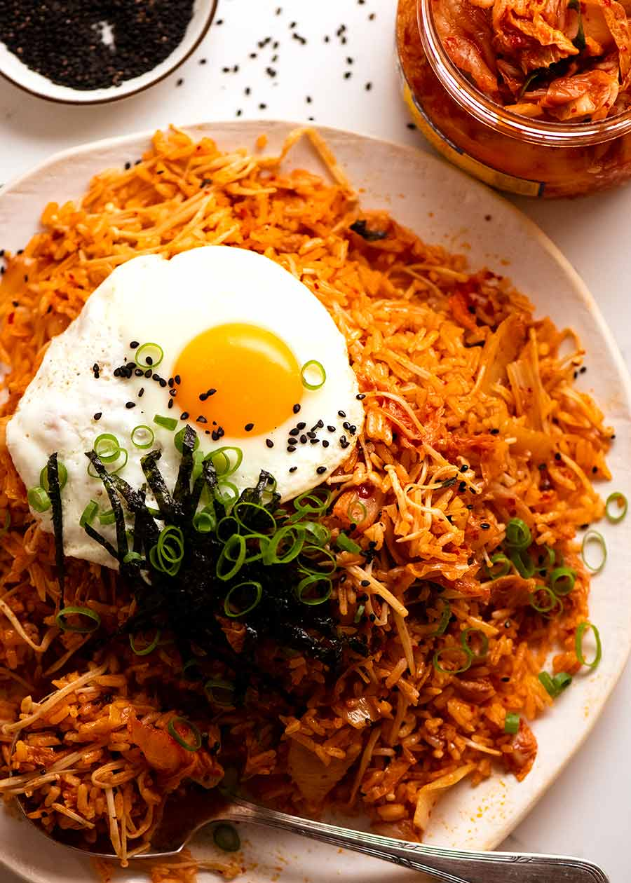 Plate of Kimchi Fried Rice topped with fried egg, ready to be served