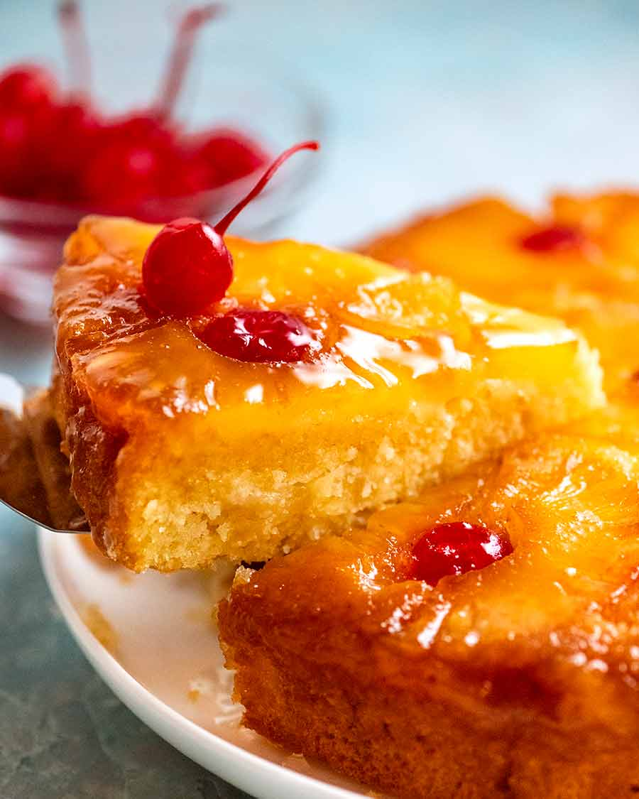 Picking up a slice of Pineapple Upside Down Cake
