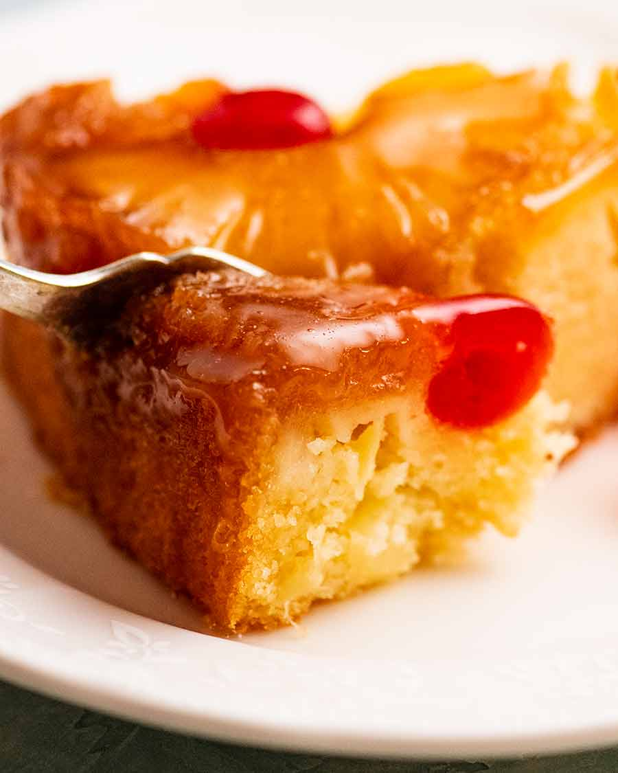 Close up of fork eating Pineapple Upside Down Cake