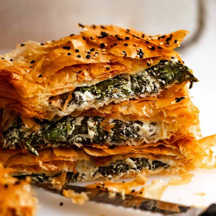 Stack of freshly baked Spanakopita slices