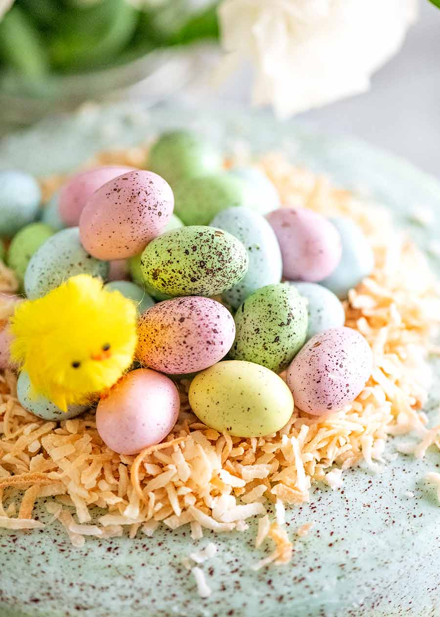 Pile of mini speckled Easter eggs on an Easter Cake - Easter Cake decorating idea