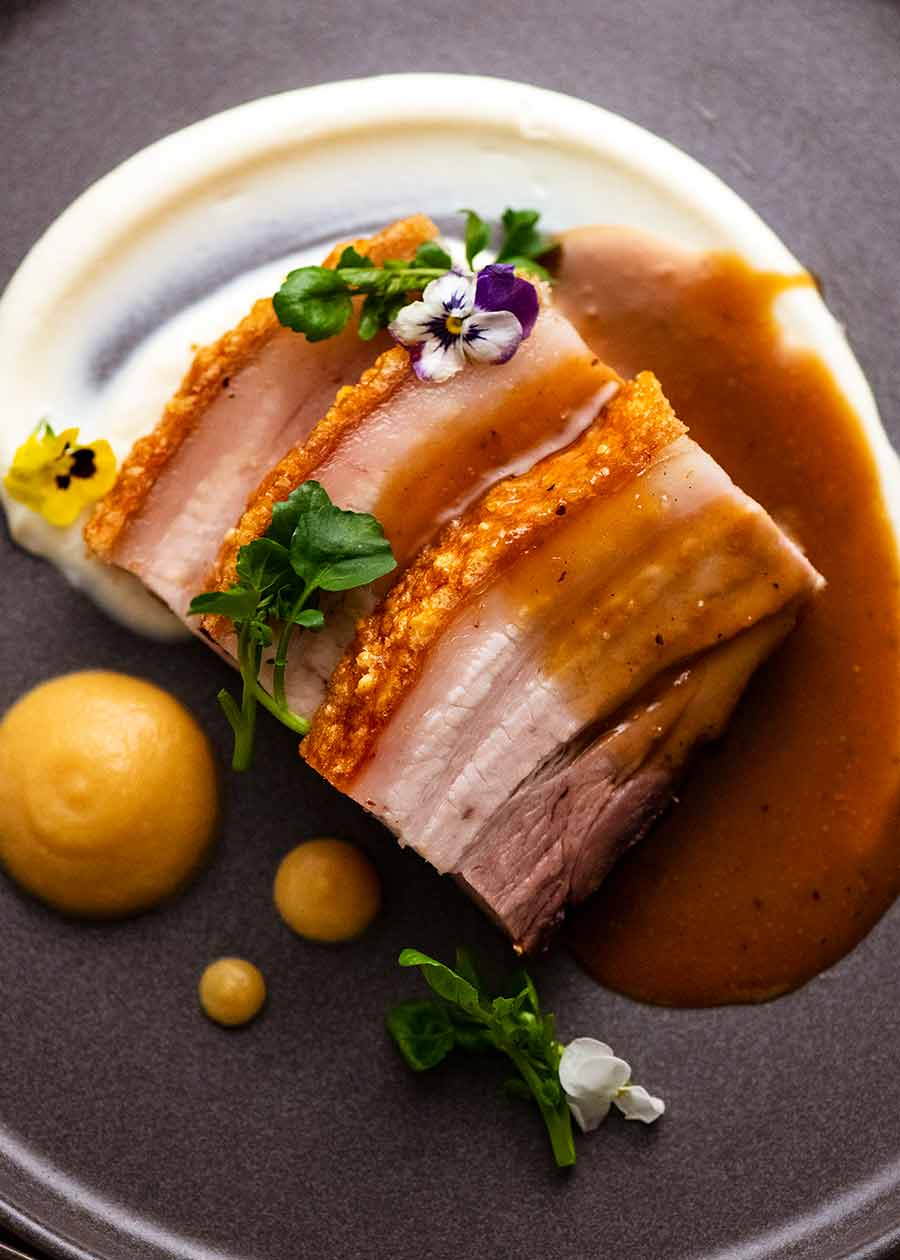 Fine dining restaurant plating of Slow Roasted Crispy Pork Belly