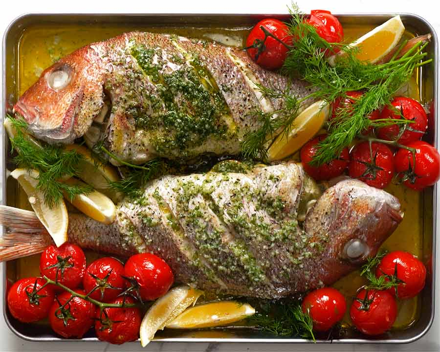 Freshly baked whole snapper with lemon butter dill sauce