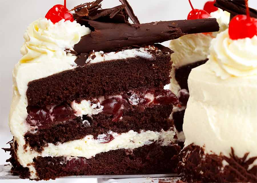 Pulling out a slice of Black Forest Cake