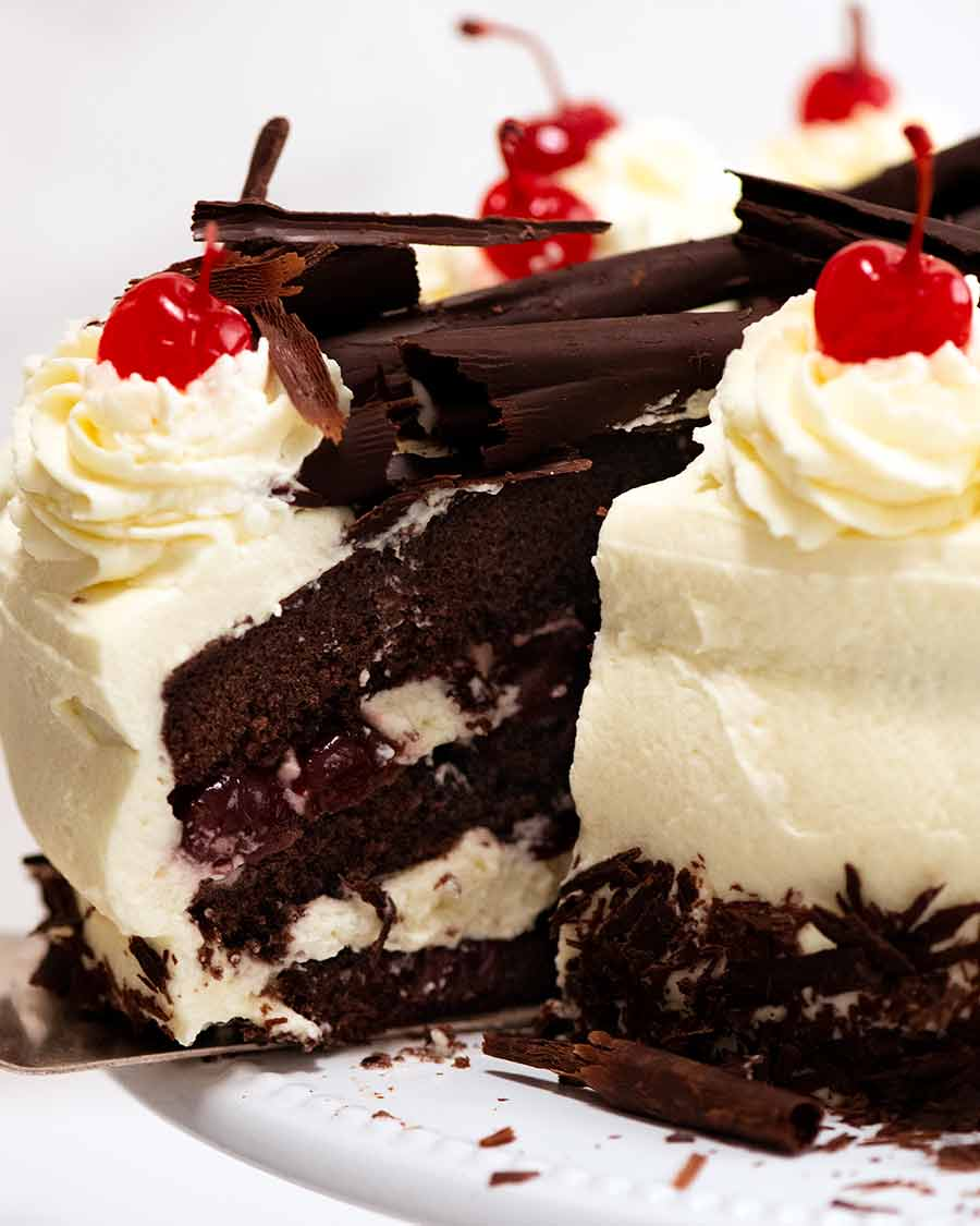 Close up of a slice of Black Forest Cake being pulled out