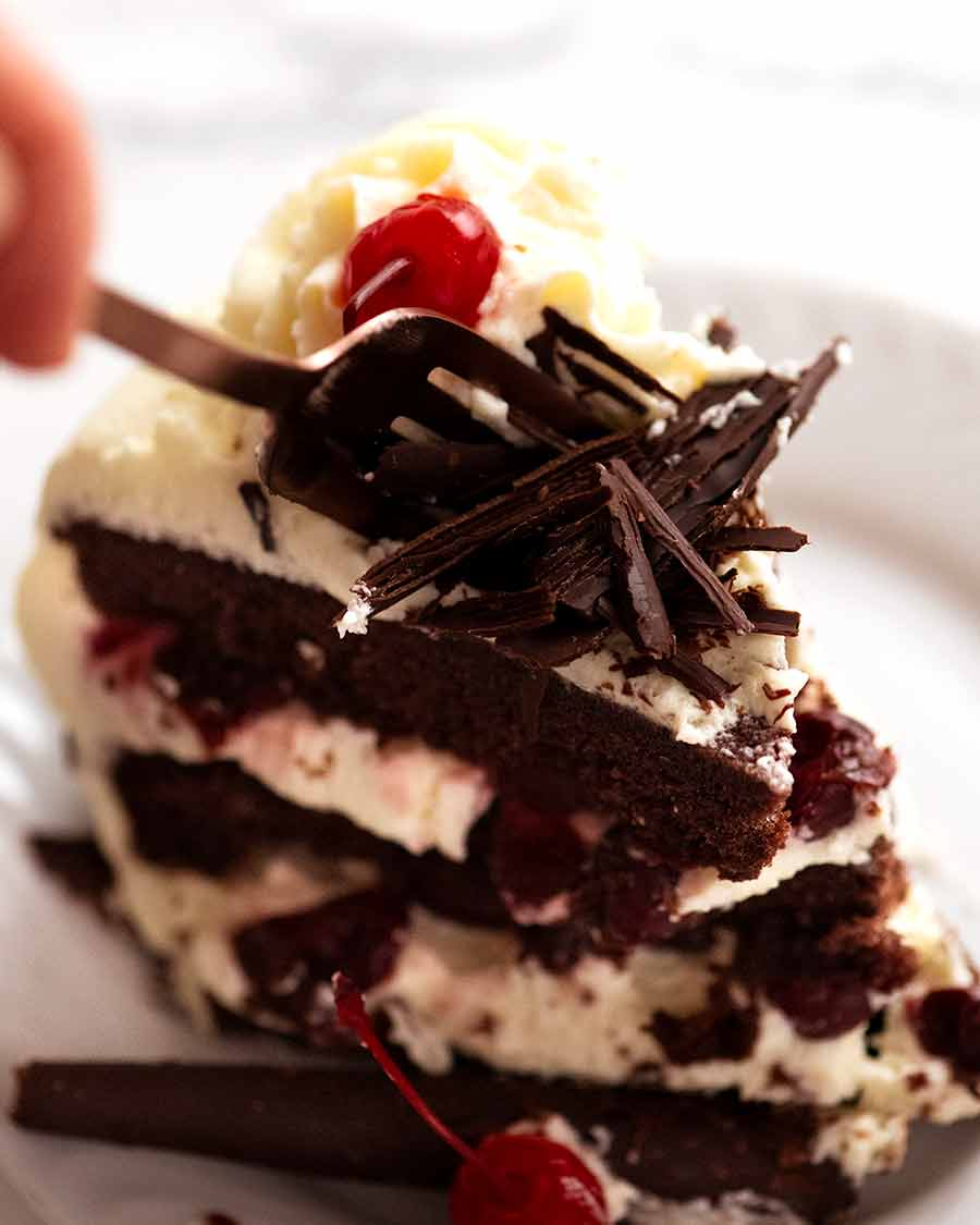 Fork cutting into a slice of Black Forest Cake
