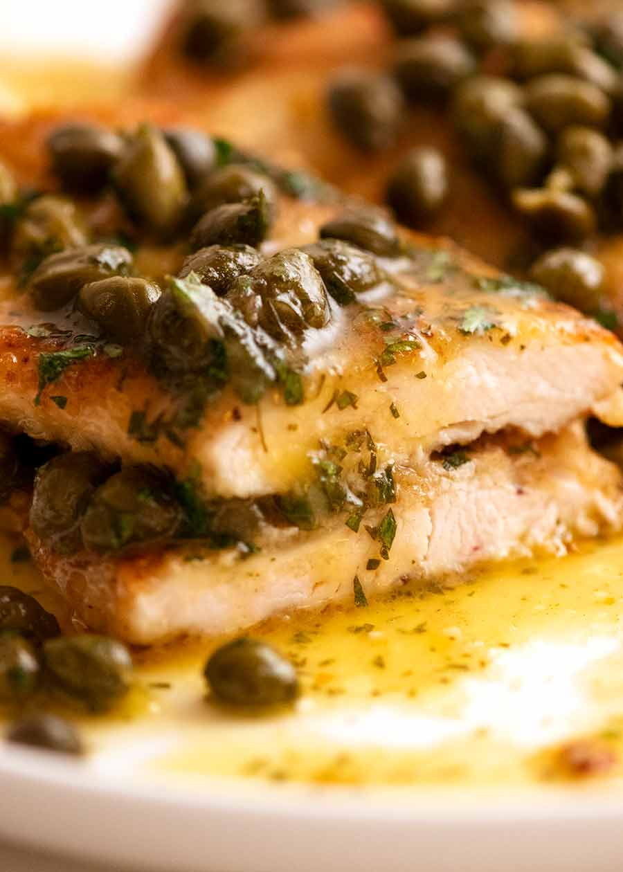 Close up of cut pieces of Chicken Piccata