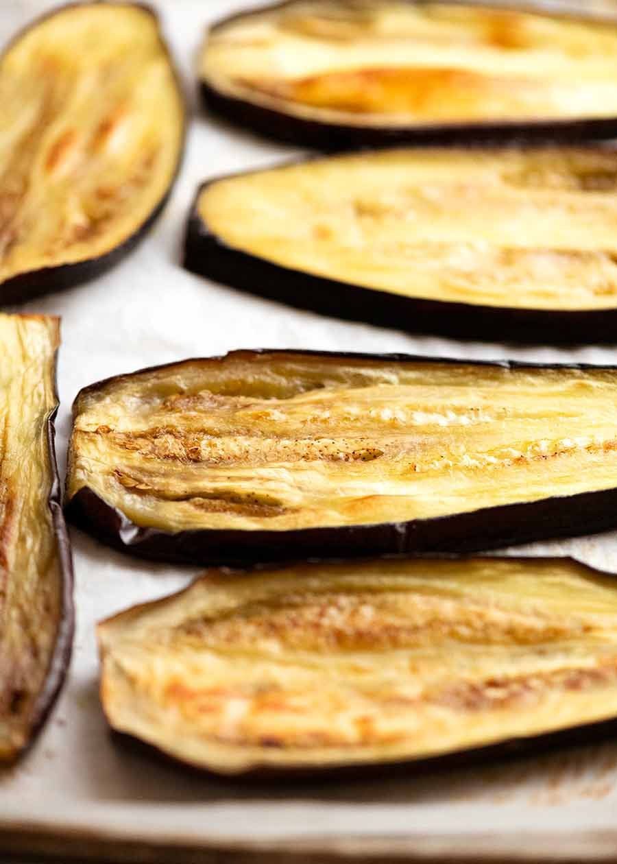 Close up of baked slices of eggplant for Eggplant Parmigiana