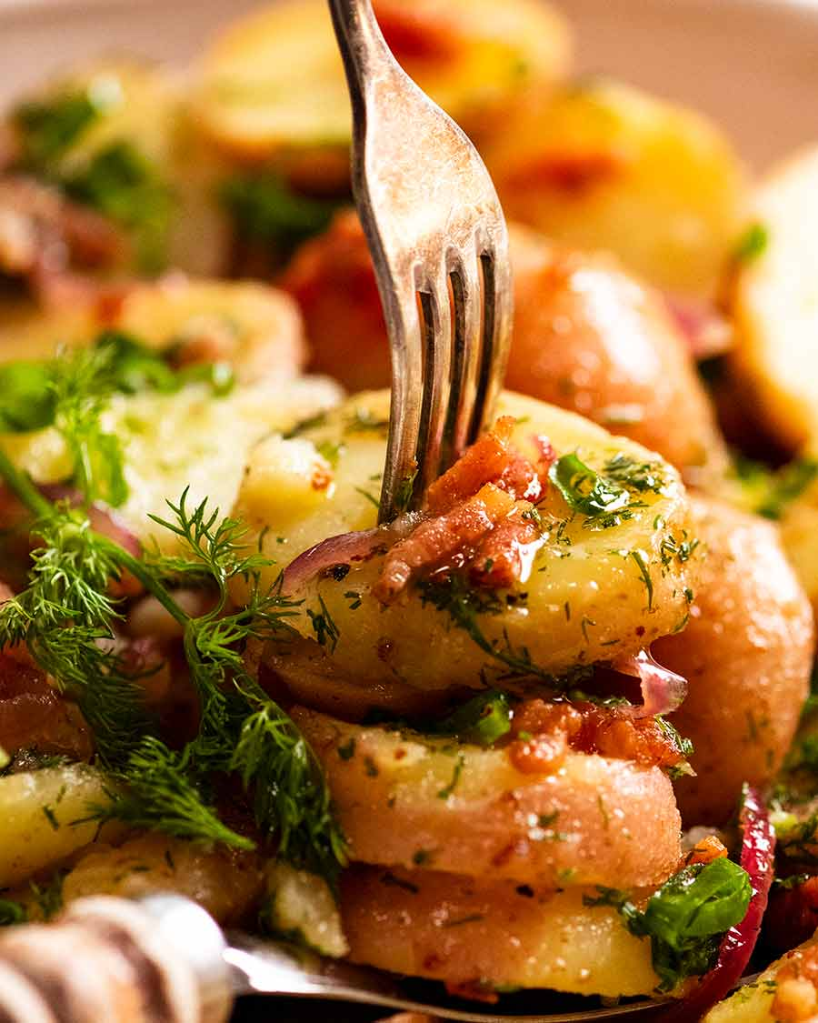 Close up of fork picking up a piece of German Potato Salad