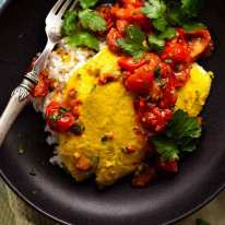 Overhead photo of Golden Turmeric Fish (Indonesian) made with John Dory served on rice, ready to be eaten