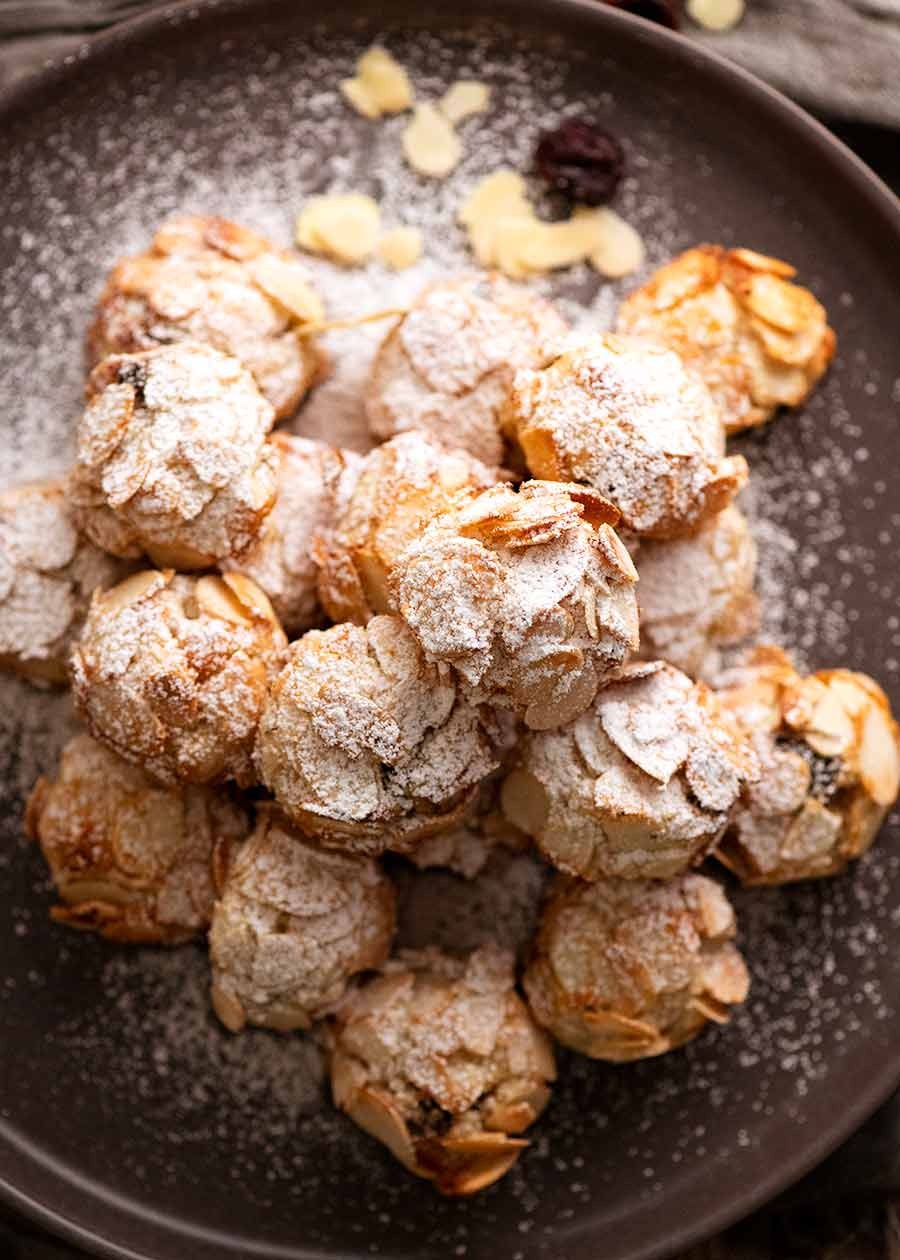 Overhead photo of Italian Almond Cookies on a plate, dusted with icing sugar