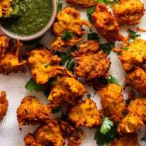 Fresh cooked Pakora with Coriander Mint dipping sauce