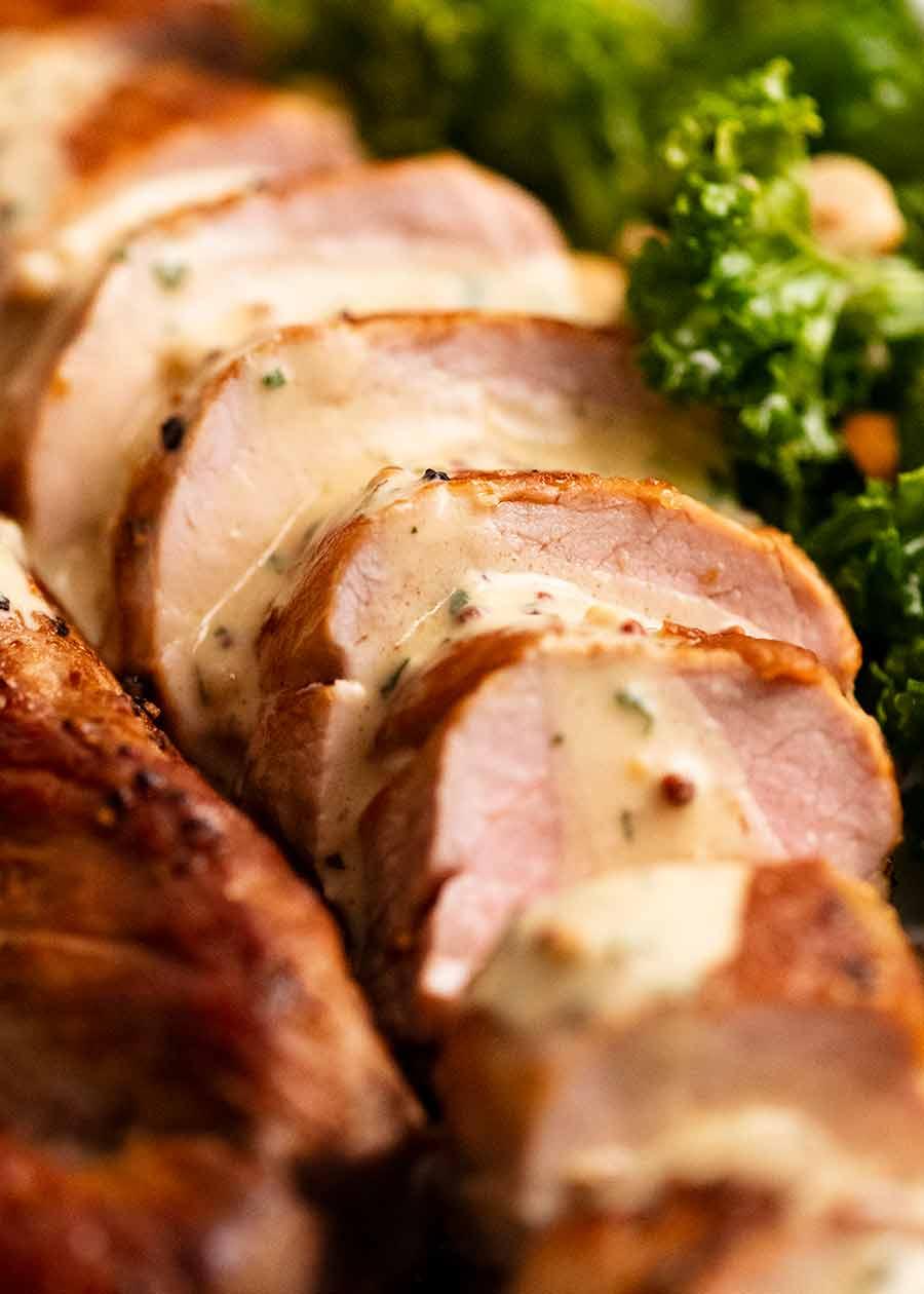 Close up of slices of Pork Tenderloin with Creamy Mustard Sauce