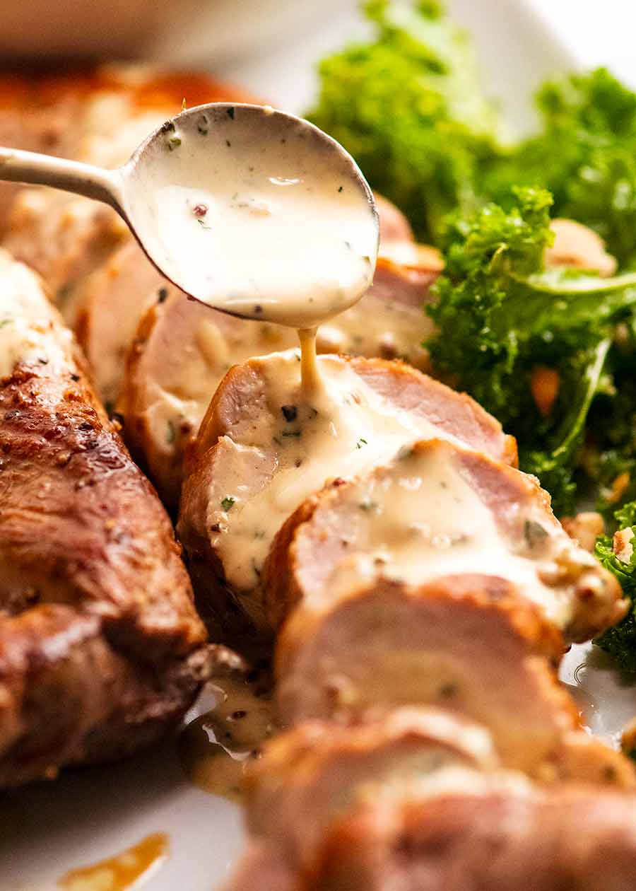 Spooning Creamy Mustard Sauce over Pork Tenderloin