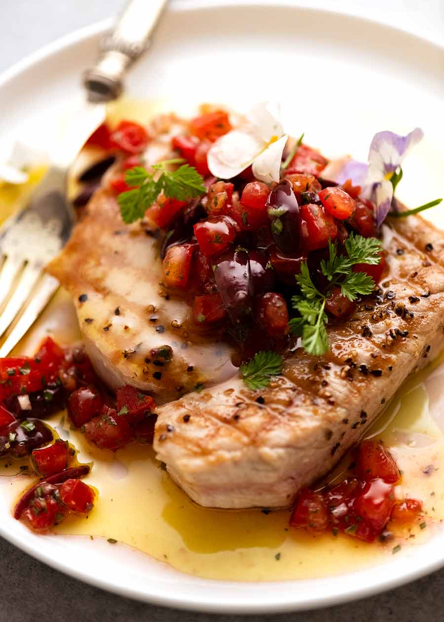 Tuna Steak with Sauce Vierge (French Salsa for fish) on a plate, ready to be eaten