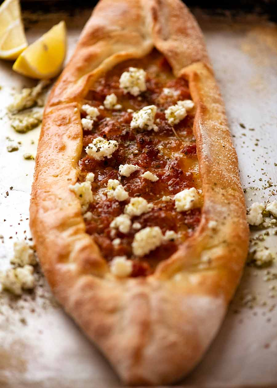Turkish Sausage Pide on a tray, fresh out of the oven