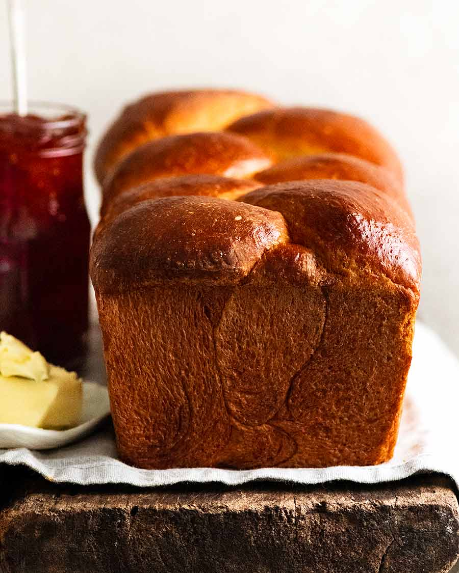 Freshly made Brioche with butter and jam