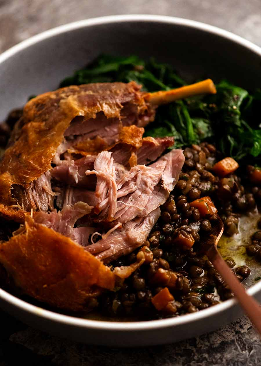 Showing the tender flesh of Duck Confit