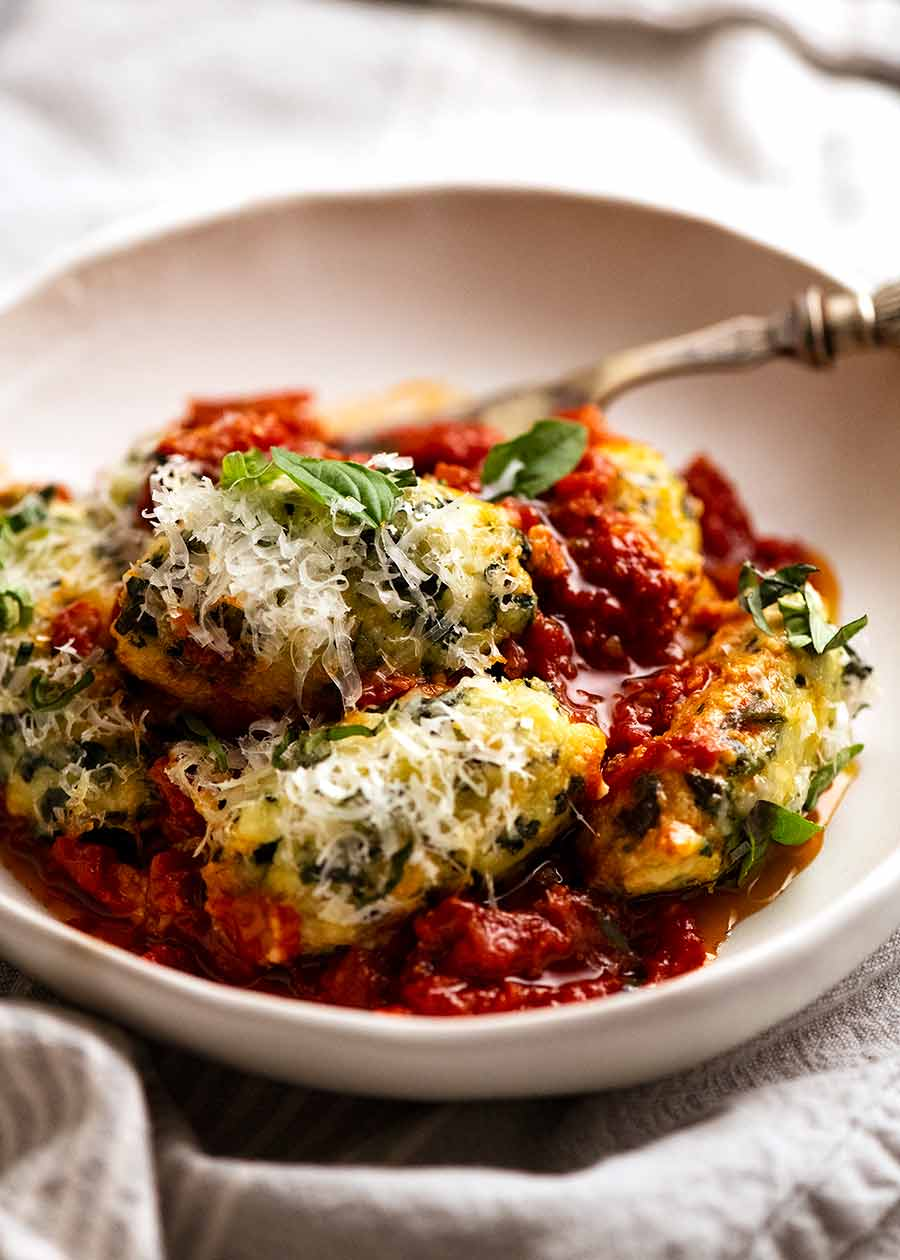 Bowl of Malfatti - Italian Spinach Ricotta Dumplings, ready to be eaten