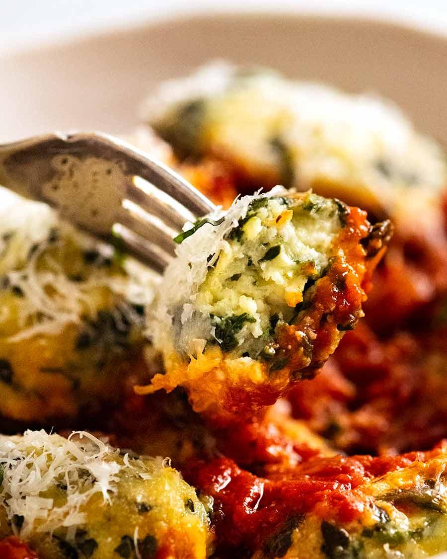 Close up showing inside of Malfatti - Italian Spinach Ricotta Dumplings