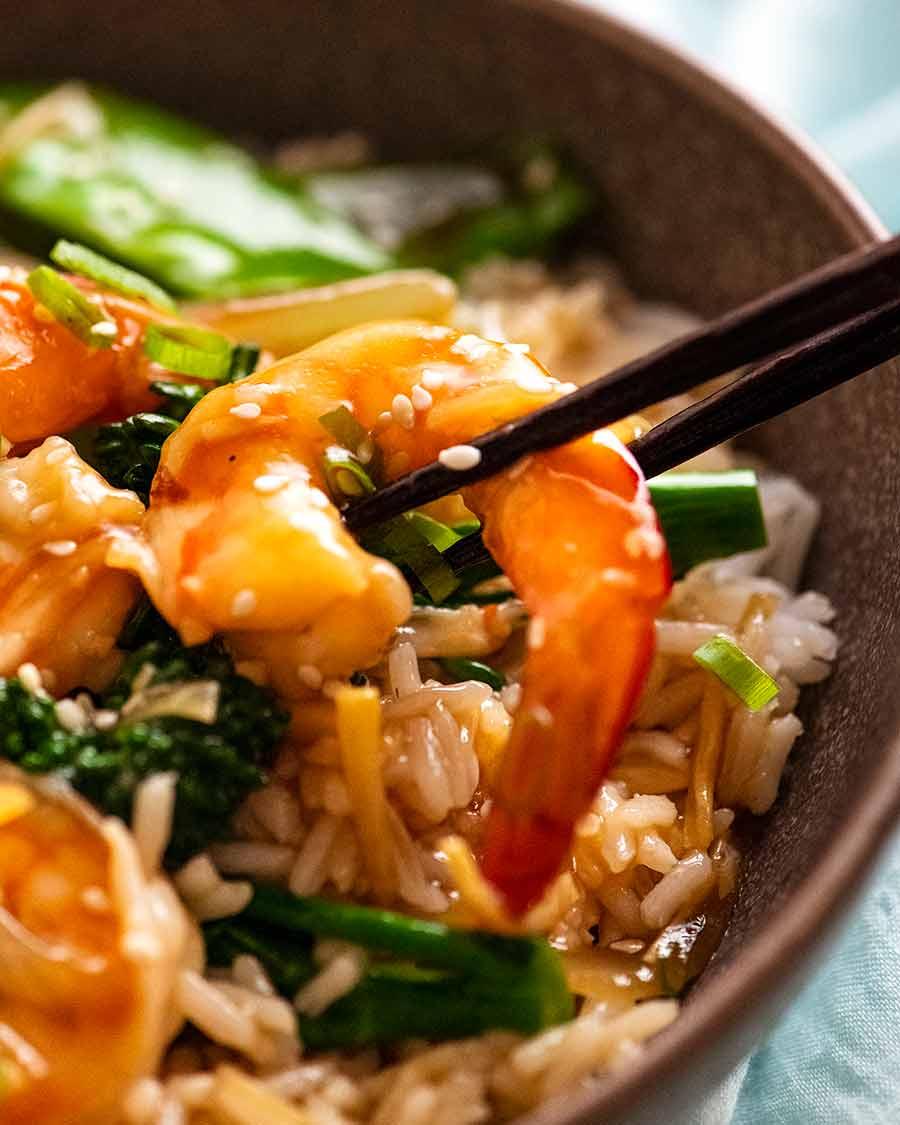Close up photo of chopsticks picking up a prawn in a Prawn Stir Fry (Shrimp)